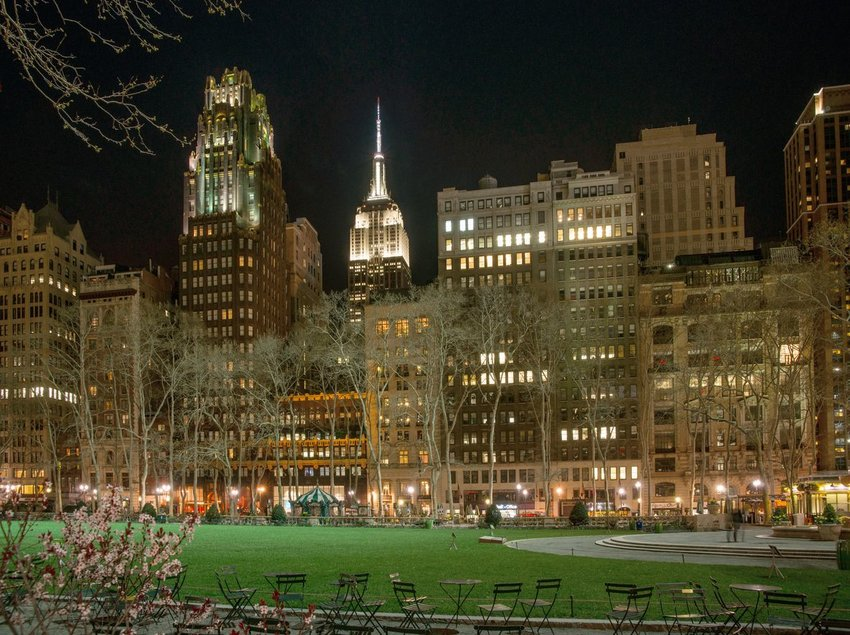 View of buildings in New York City with Bryant Park Hotel on the left