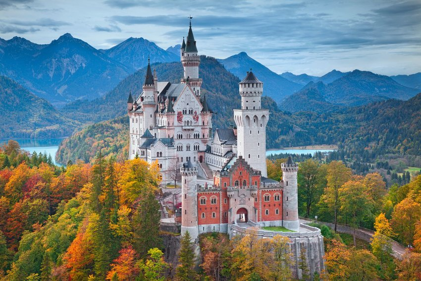 Colorful mountains and forests surrounding the castle Neuschwanstein in Bavaria
