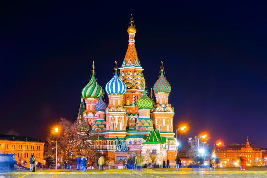 Colorful St. Basil's Cathedral in Moscow, Russia lit up at night under a clear sky
