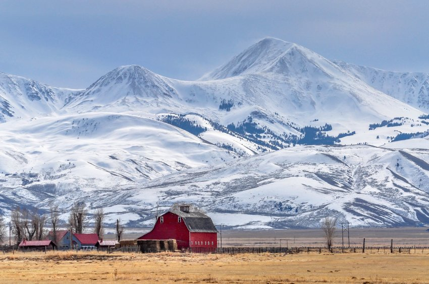 Montana barn and mountains in winter