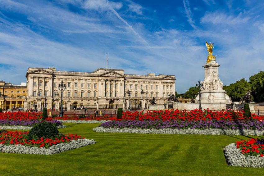 Buckingham Palace with flower garden in the front