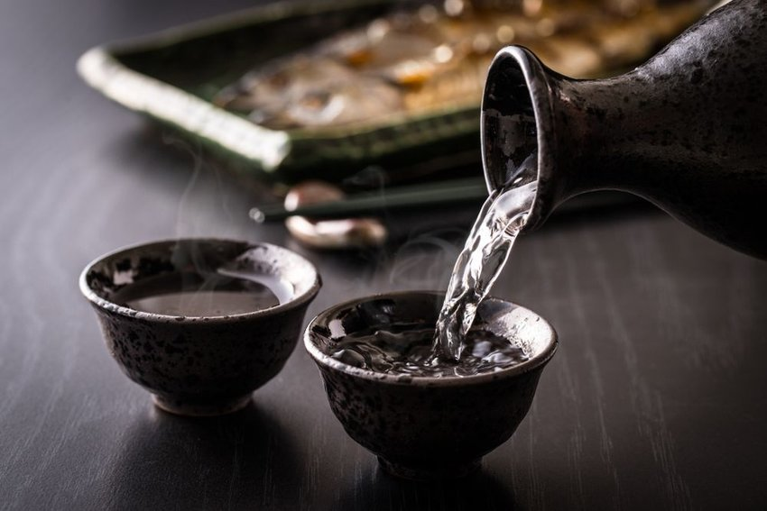 Sake being poured into two cups