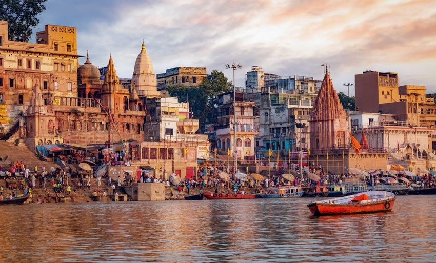 View of Varanasi from the water with boat in front