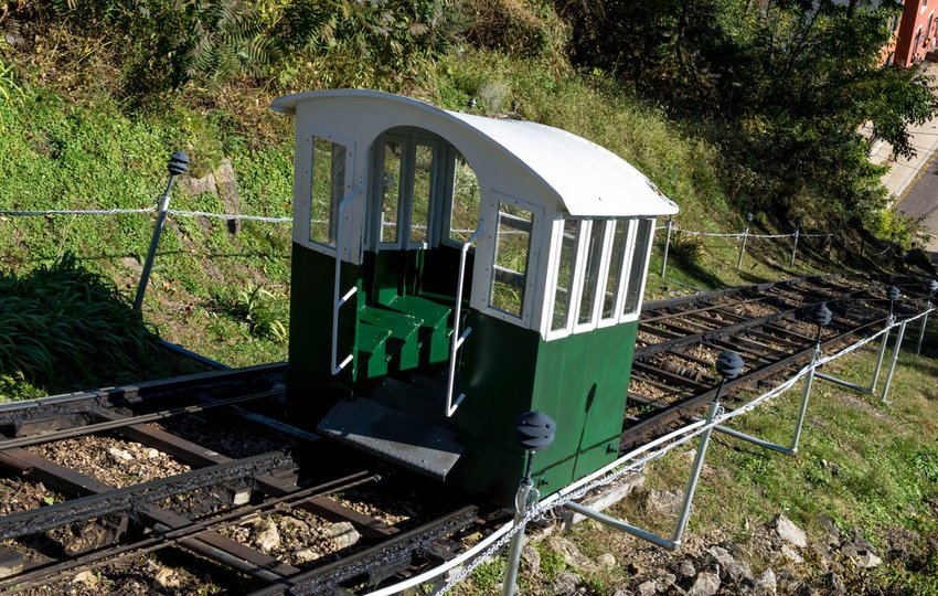 Little elevator car riding up the steepest and shortest railroad in the world