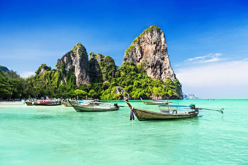 Boats sitting in the water in Thailand