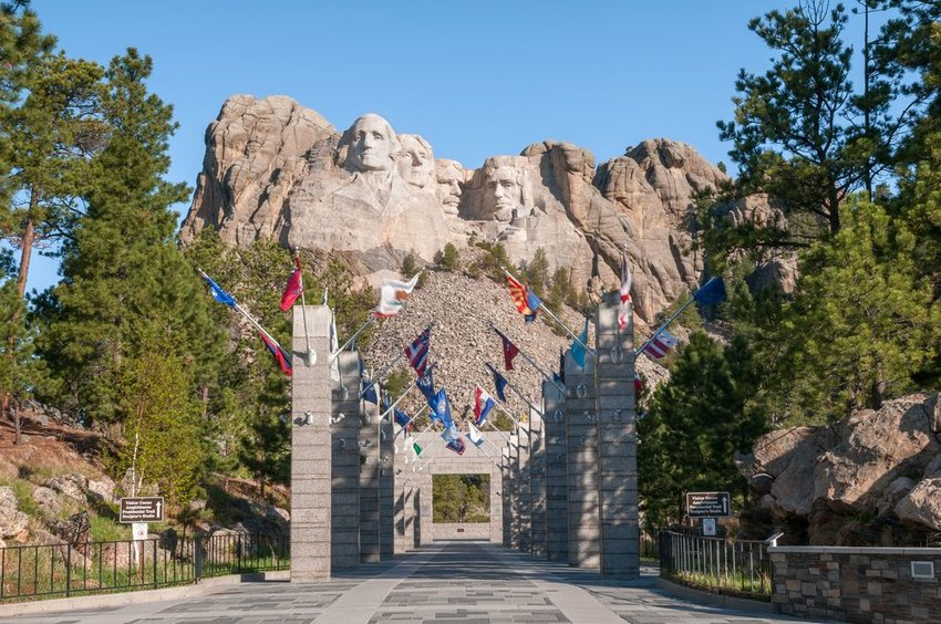 Entrance to Mount Rushmore with flags