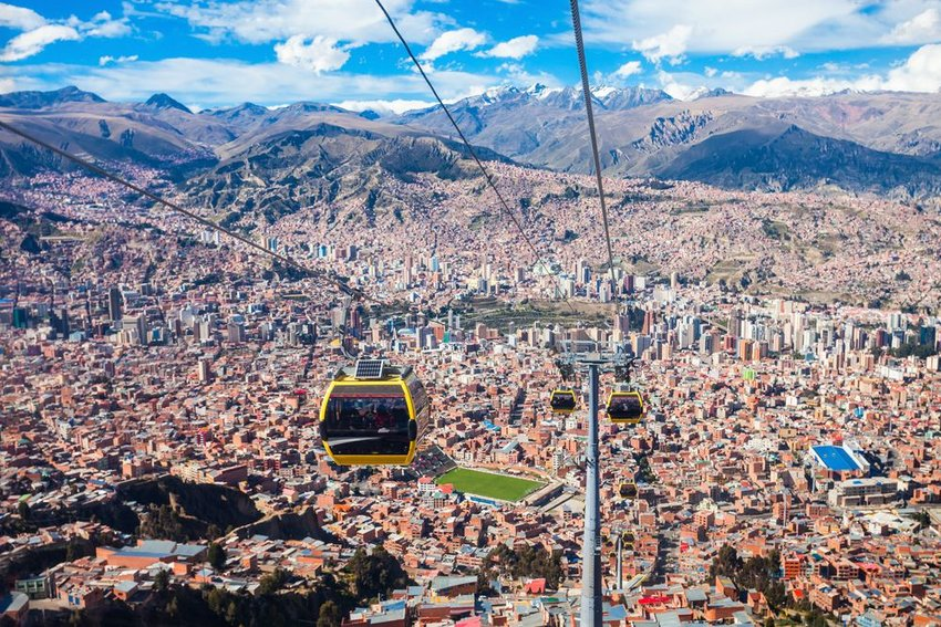 View of gondola in La Paz, Bolivia with city and mountains in background