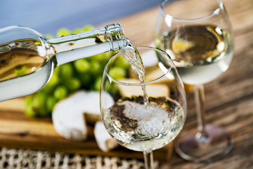 White wine pouring into a wine glass