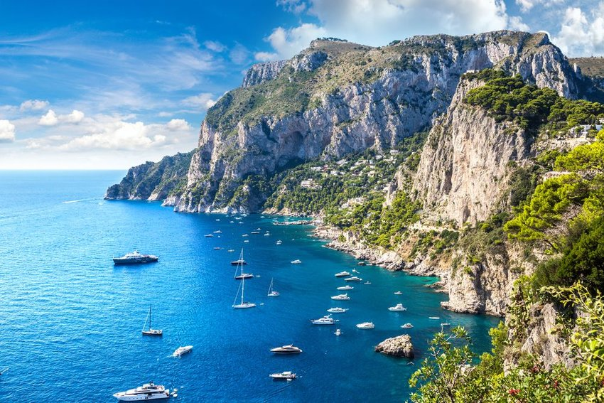 Capri island with boats in the water off the shore