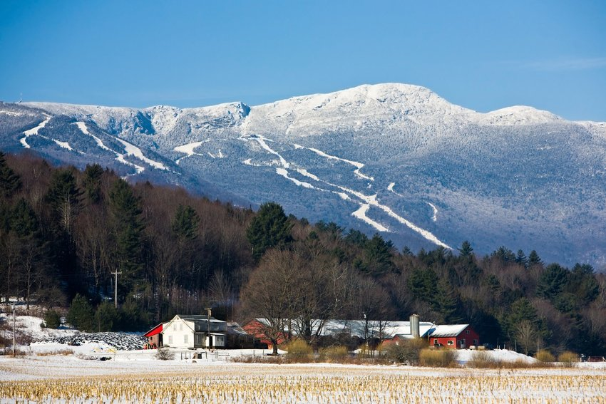 Stowe, Vermont in winter with homes and mountains