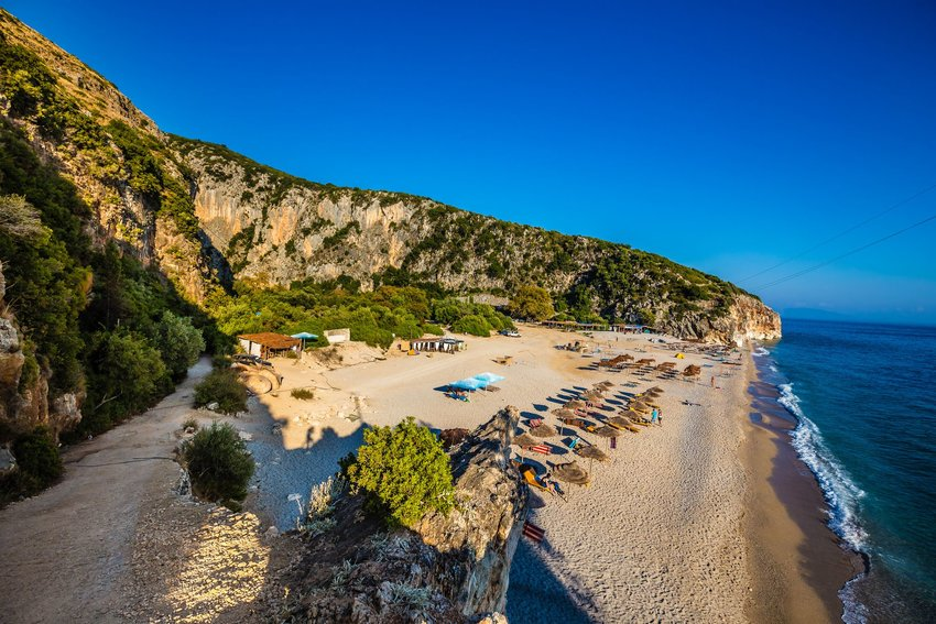 Sandy hills and the ocean at Gjipe Beach in Himare, Vlore, Albania