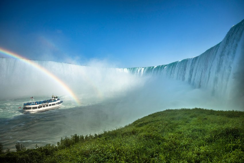 Horseshoe Falls and a tourist ferry boat from underneath the Niagara Falls