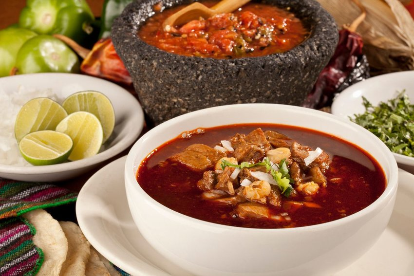 Guadalajara red pozole in a white bowl