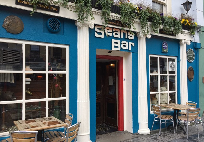 Exterior of Sean's Bar with seating outside
