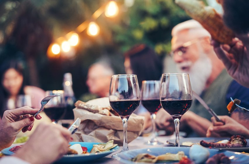 People eating food and wine outdoors