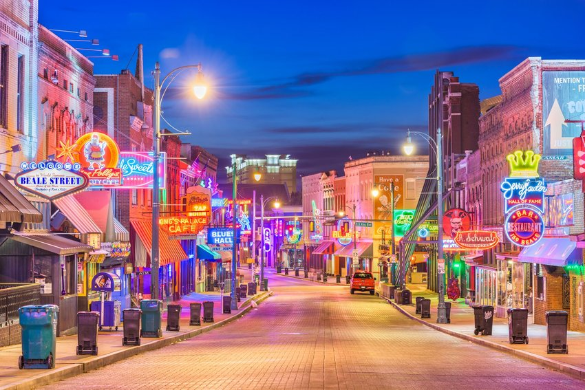The colorful lit signs of Beale Street at night in Memphis, Tennessee.