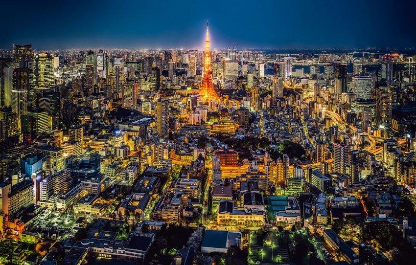 Aerial view of Tokyo at night with the Tokyo Tower lit up in center
