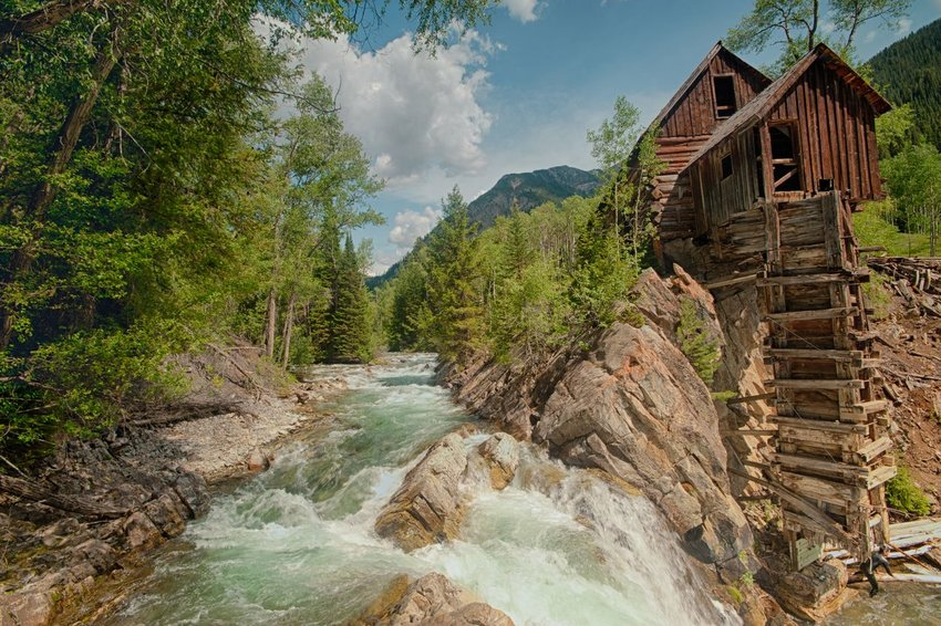 An abandoned mining operation on a river in the forest near Marble, Colorado.