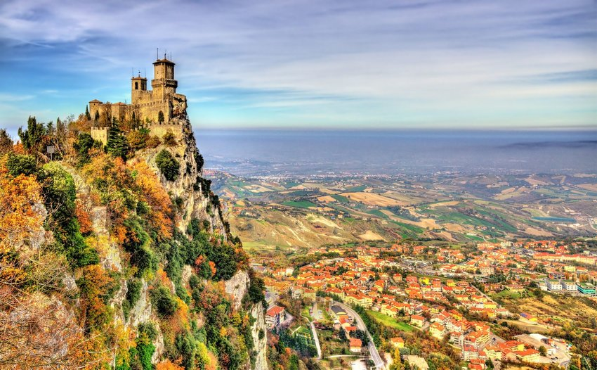 Guaita, the First Tower, overlooking colorful San Marino on a bright day