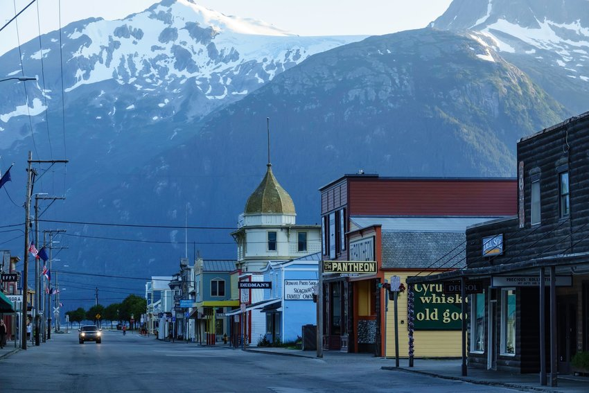 Enormous mountains looming over the small town of Skagway in Alaska