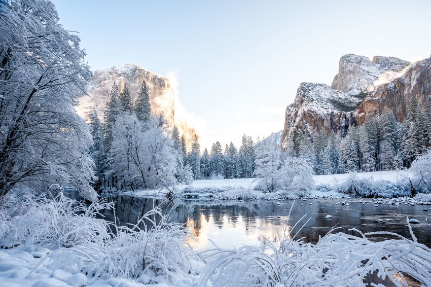 Freshly fallen snow and a river in Yosemite National Park.