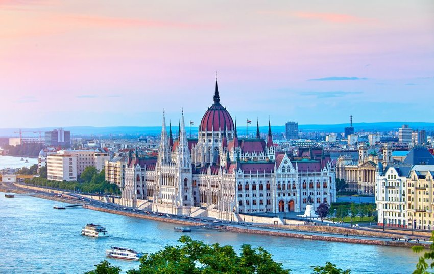 Hungarian Parliament Building seen from across a river with city in background