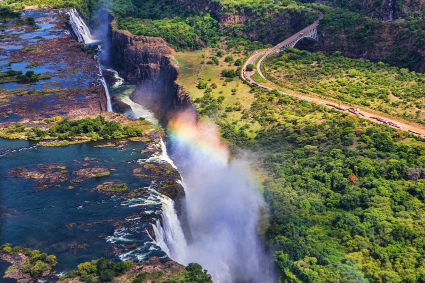 Aerial view of Victoria Falls with road and bridge in background