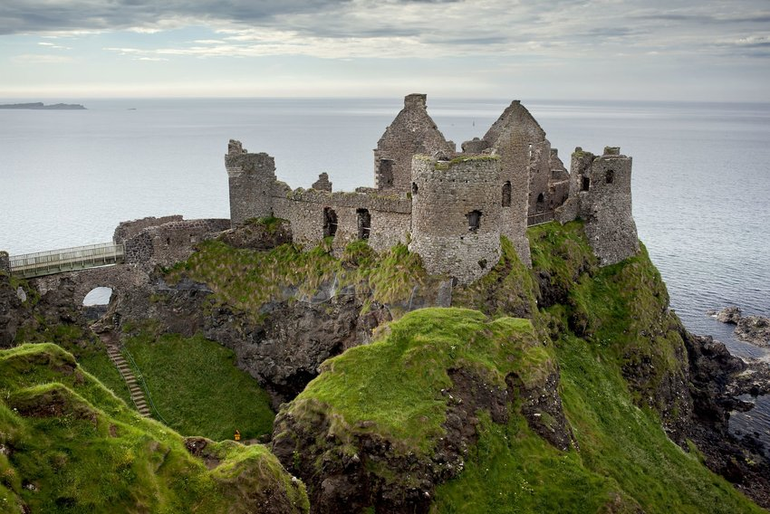 The old ruins of Dunluce Castle looking out over the ocean
