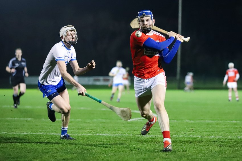 Action shot of athletes playing munster hurling at the Gaelic Games in 2018
