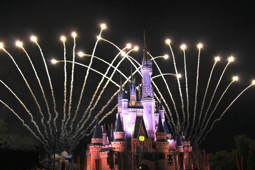Cinderella's Castle at night with fireworks going off in the background
