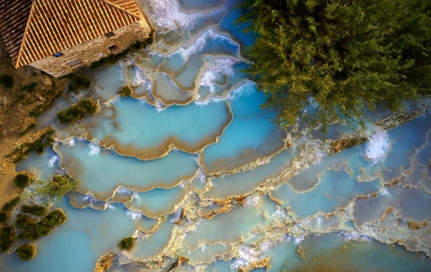 Aerial view of natural hot springs and waterfalls