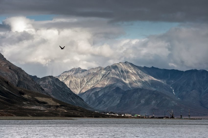 A view of a small Russian fishing town and mountains off the coast of the Bering Strait