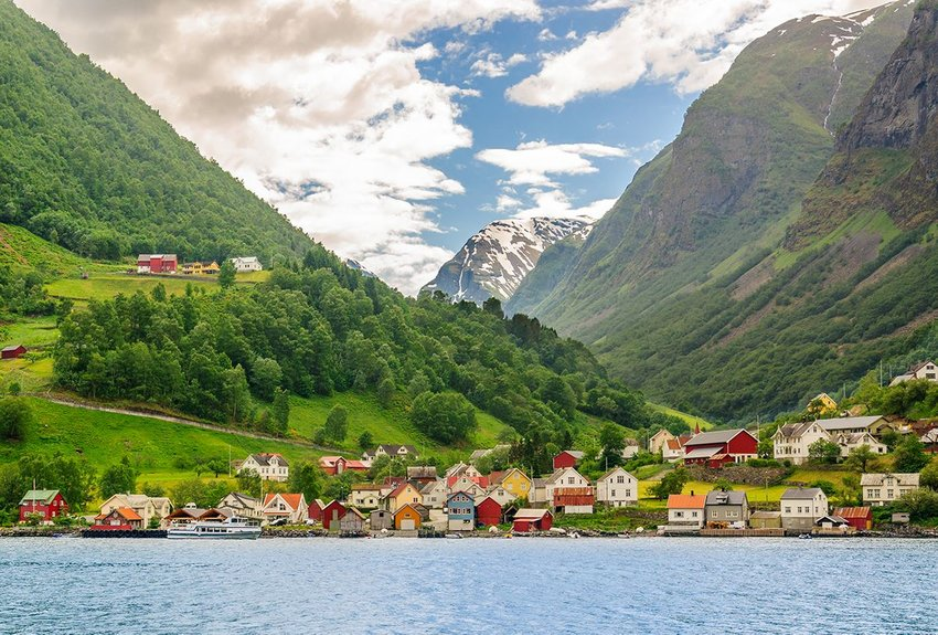 Colorful traditional Norwegian houses along the Flam Railway route