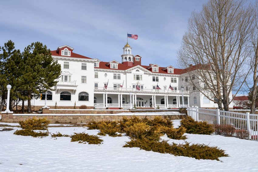 The red and white facade of The Stanley Hotel in Estes Park, Colorado on a snowy day.