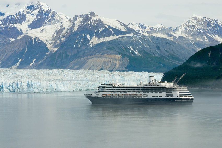 Cruise ship in Alaska with iceberg in background