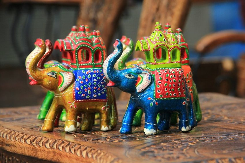 Elephant souvenirs displayed on a wooden table