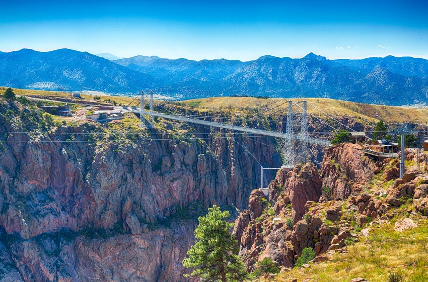 The Royal Gorge suspension bridge with mountains in the background in Colorado