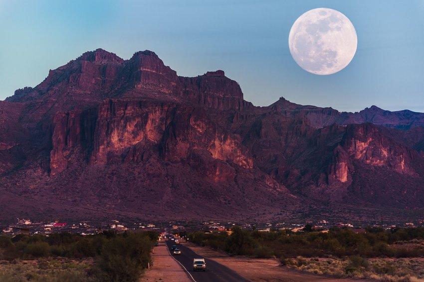 Supermoon over rocky mountains