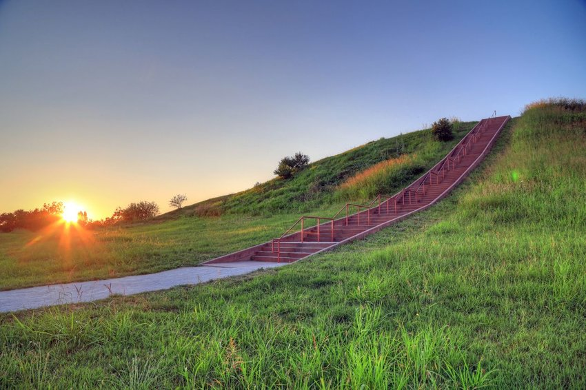 Staircase going up a mound covered in grass