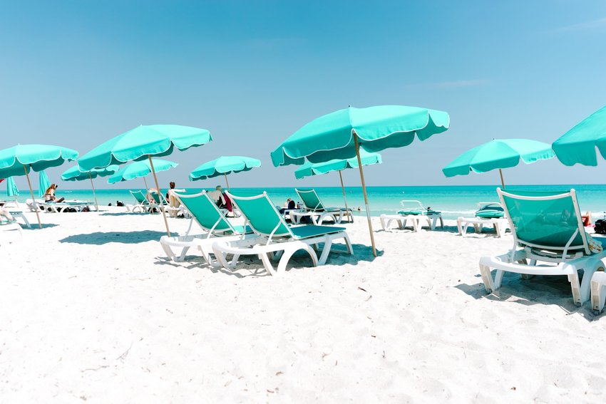 Lounge chairs with umbrellas on the beach