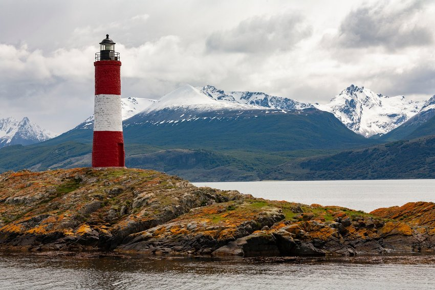 Les Eclaireurs lighthouse with snow-capped mountains
