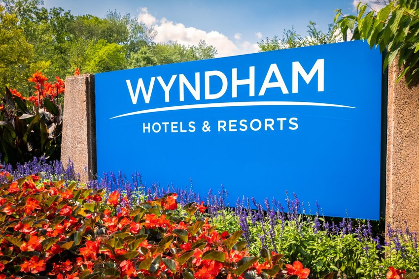 Blue Wyndham sign surrounded by foliage