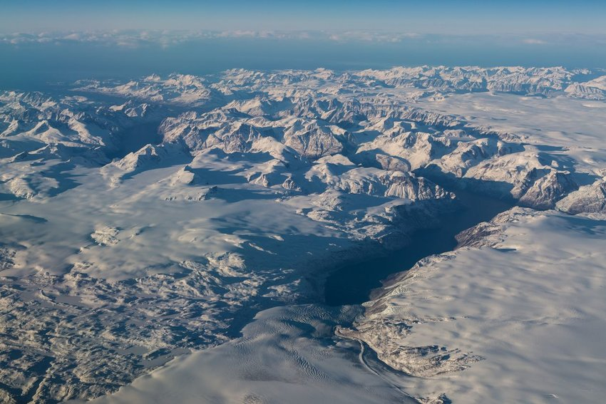 Aerial view of snowy mountain ranges in Greenland