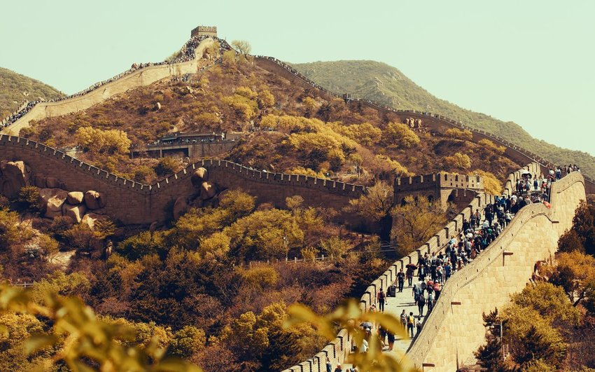Visitors walking at the Great Wall of China in autumn