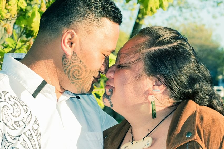 Portrait of a Maori couple with tattoos