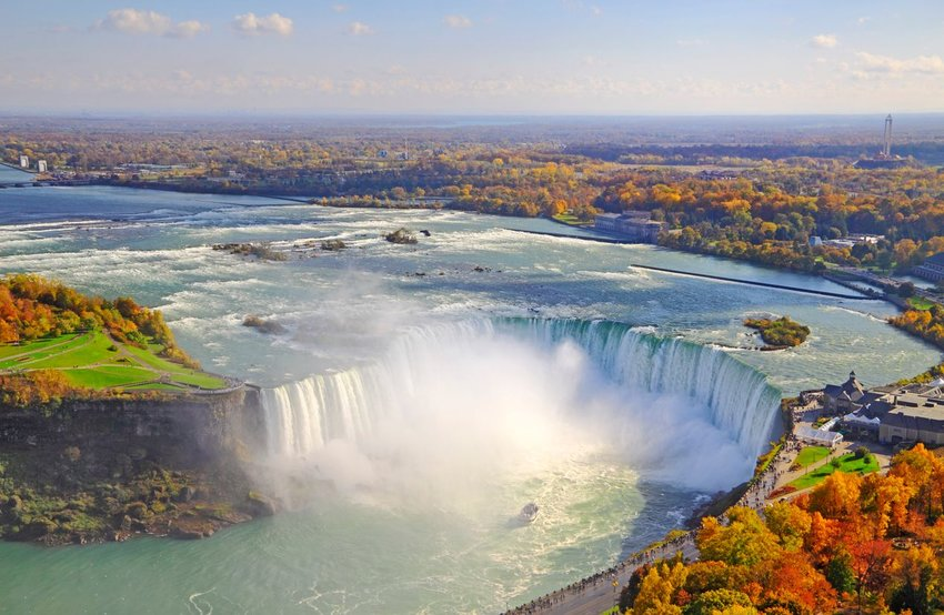 Aerial view of Niagara Falls with fall trees surrounding