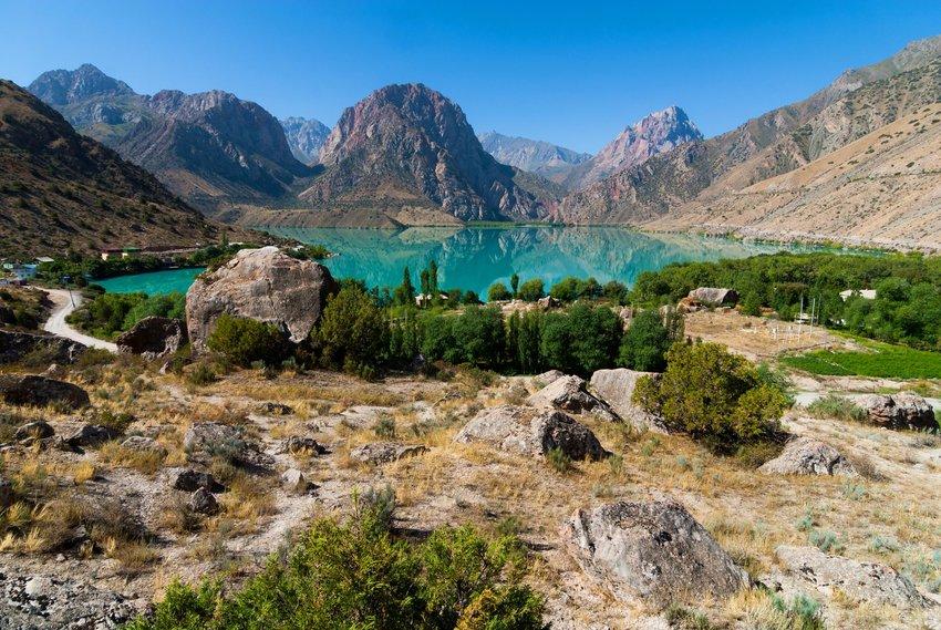 Crystal blue Iskanderkul lake in Central Asia, Tajikistan among the mountains