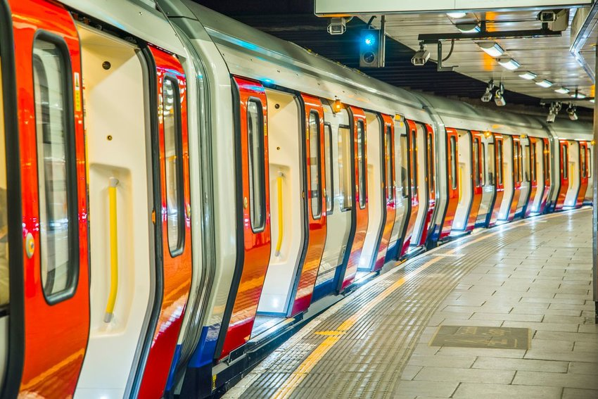 The London Underground rail with all the doors open, stopped at a platform