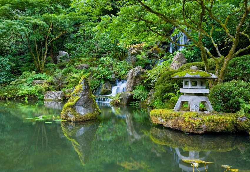Waterfalls, trees, and shrine in Portland Japanese Garden