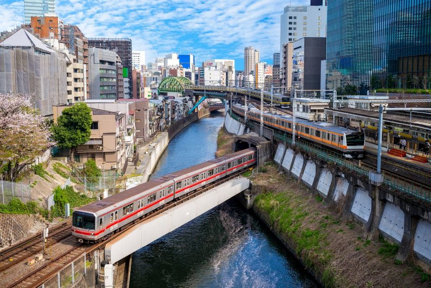 Multiple metro trains on different tracks in Tokyo